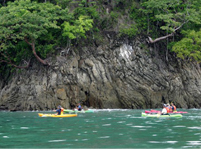 People kayaking in marino ballena national park