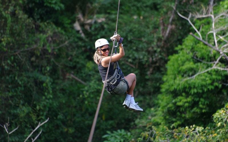 Person doing canopy tour in Costa Rica's rainforest
