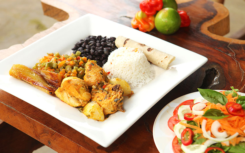 A delicious casado, the typical Costa Rican lunch. Rice, beans, bananas, chicken, vegetables and salad make up the dish.