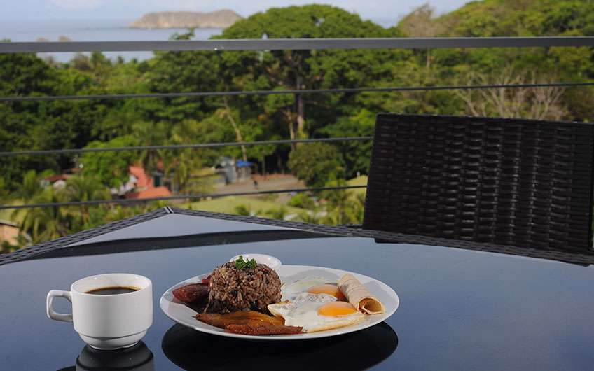 Typical Food Costa Rica Gallo pinto with eggs and coffee