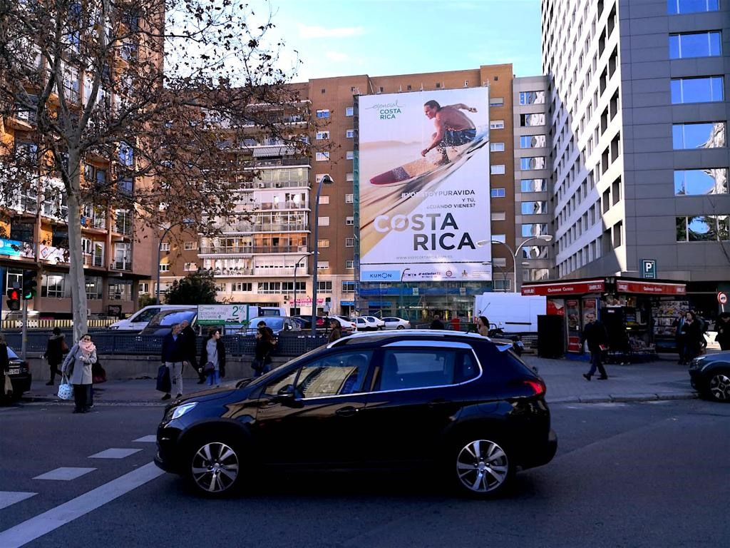 Billbpoard lacated in the streets of Madrid, Spain, ICT promoting Costa Rica as a vacations destination