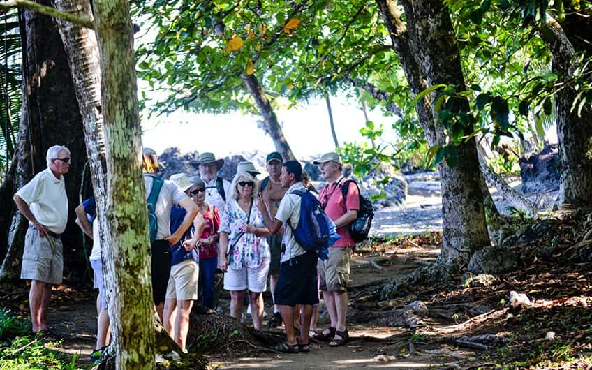 a group of elderlies having a guided tour at Manuel Antonio national park with a local tour guide