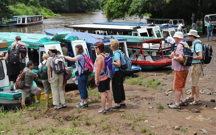 Group boarding boat to Tortuguero National Park