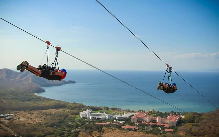 Zip lining in Guanacaste Costa Rica allows great views of the ocean and the forest while having a blast. This is the Superman of Diamante Eco Adventure Park.